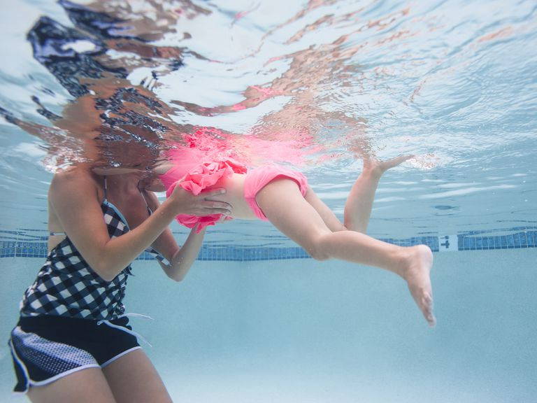 USA, Utah, Orem, Mother with daughter (4-5) swimming in pool