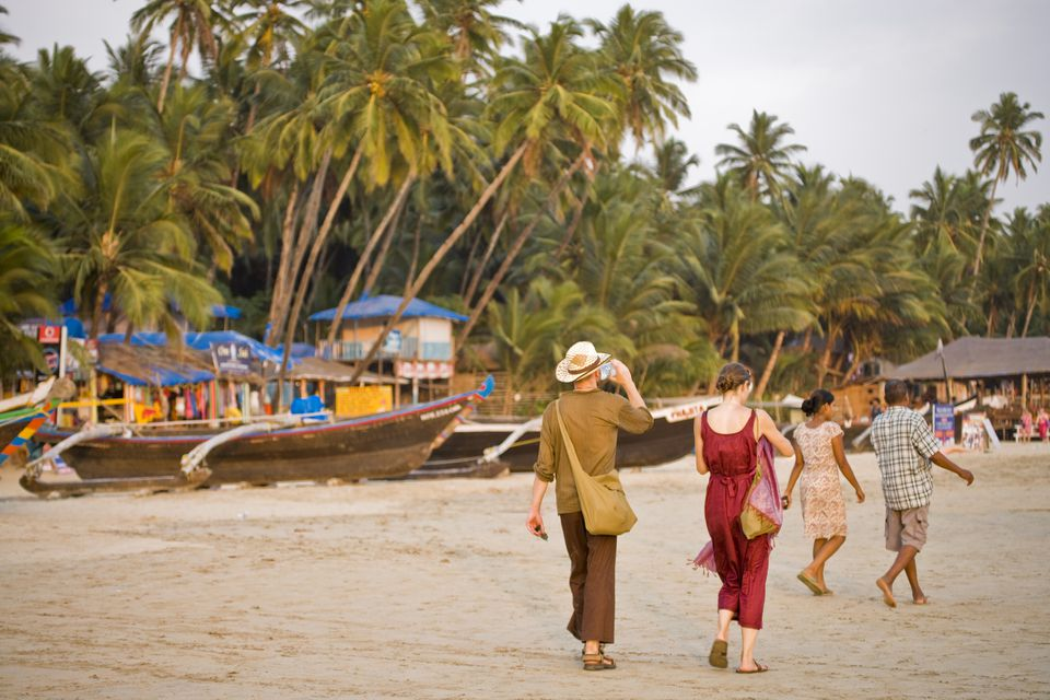 People walking on Palolem Beach.