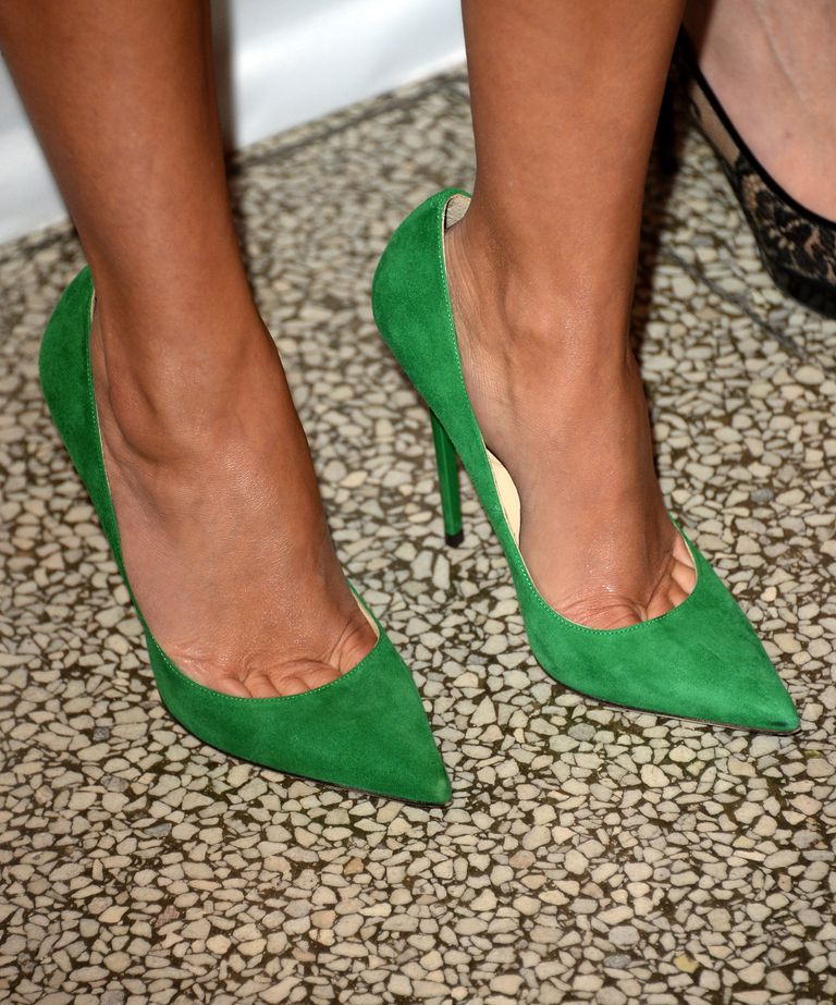 Close-up of green suede pumps, as worn by actress Reese Witherspoon.