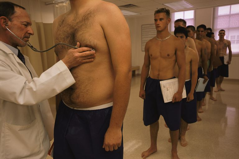 Physician Examining Fat Levels of New Military Recruits