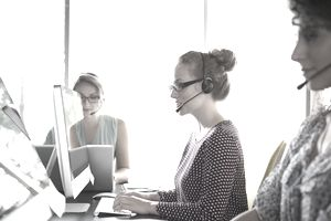 Business people with headsets working in office