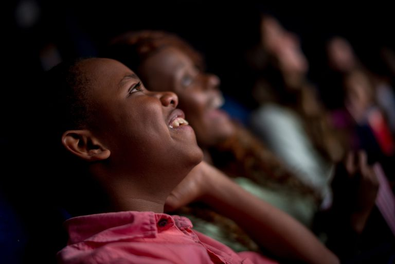 Children enjoying the movies.