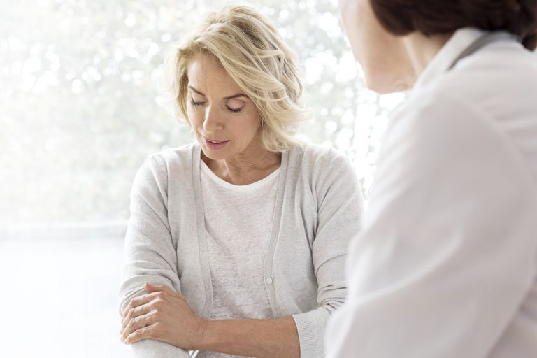 Mature woman showing gp painful arm