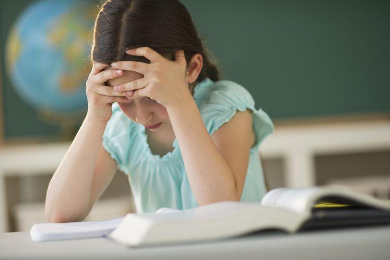 USA, New Jersey, Jersey City, schoolgirl (8-9) reading book