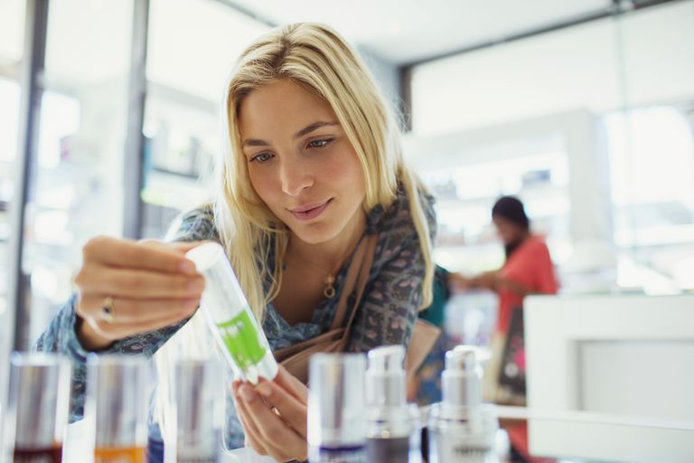 woman looking at skin care products in store