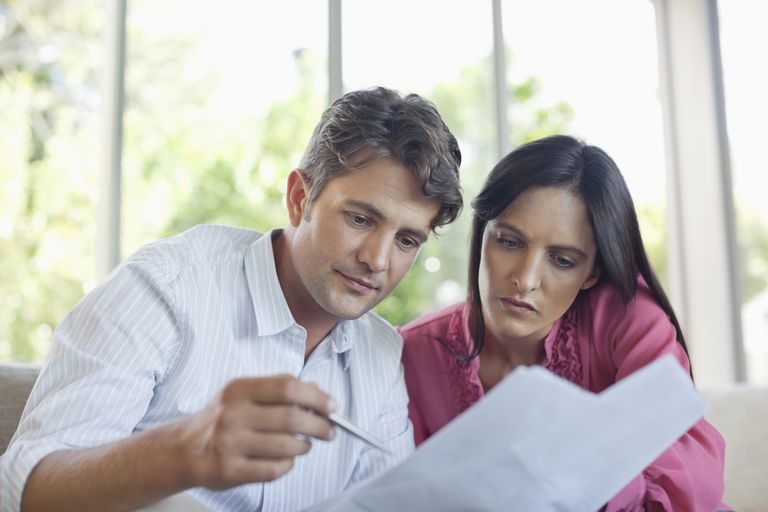 A couple reviews financial documents together