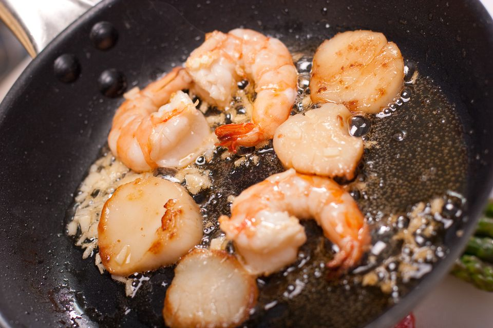 shrimp and scallops in pan