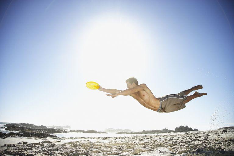 A man catching a frisbee