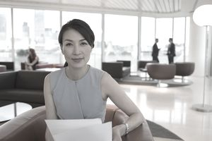 Confident businesswoman reviewing paperwork in office lounge