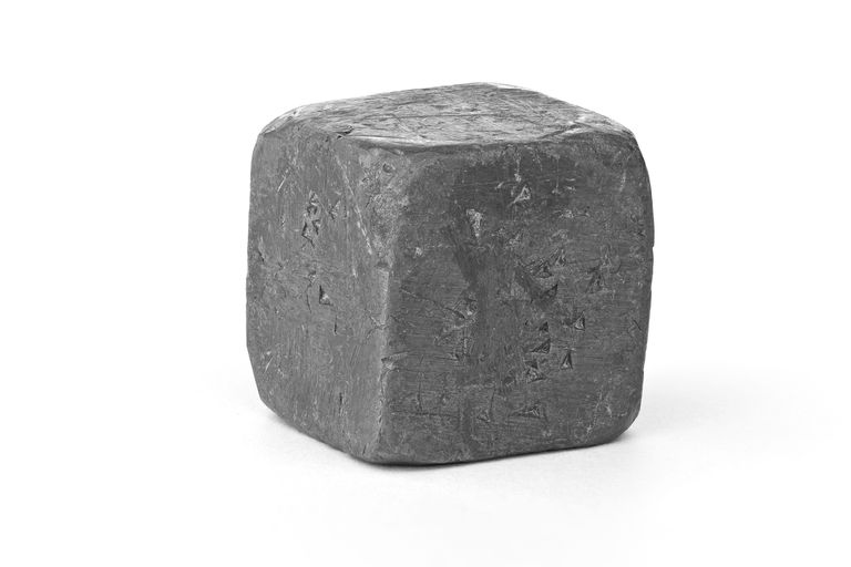 This is a cube of the element lead. Lead is a dull-looking soft, malleable, heavy metal.