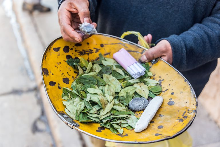 Coca Leaves And Cigarettes In Plate