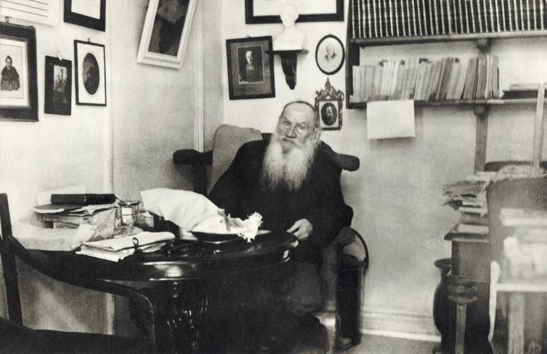 The writer Leo Tolstoy at his desk