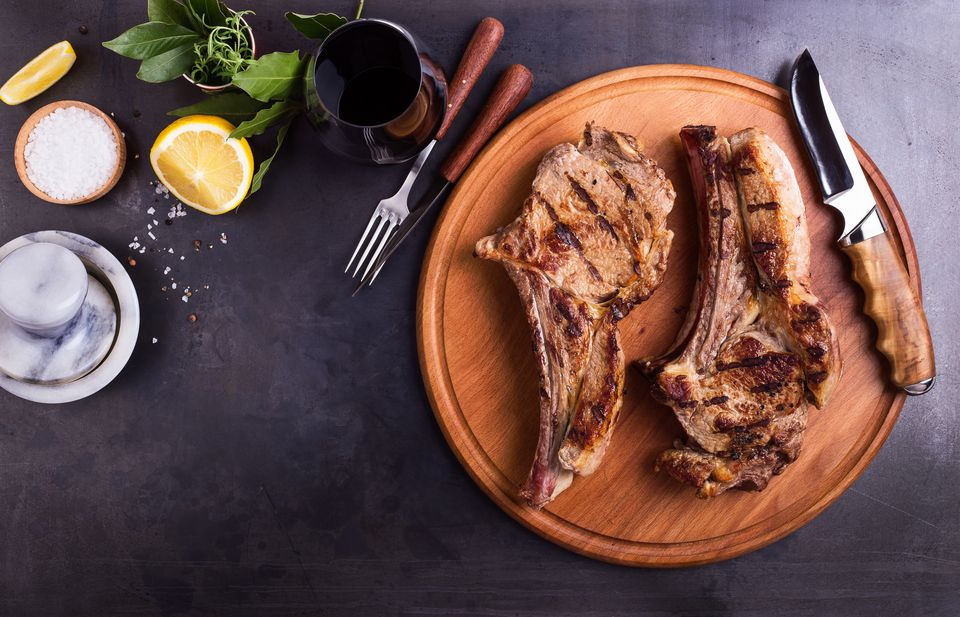 Barbecue bone-in ribeye steak on cutting board