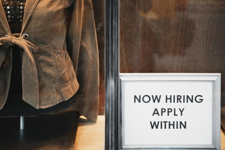 ?Now Hiring? sign in store window