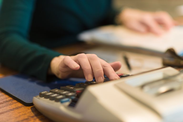 Female accountant keying in numbers