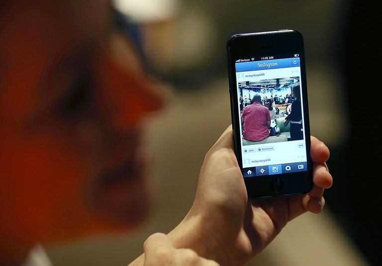 A Facebook employee demonstrates the new Instagram video option during a press event at Facebook headquarters
