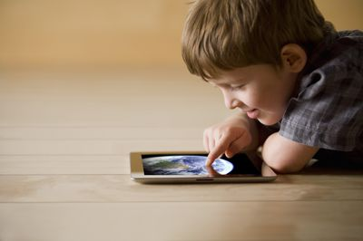 Little boy using iPad