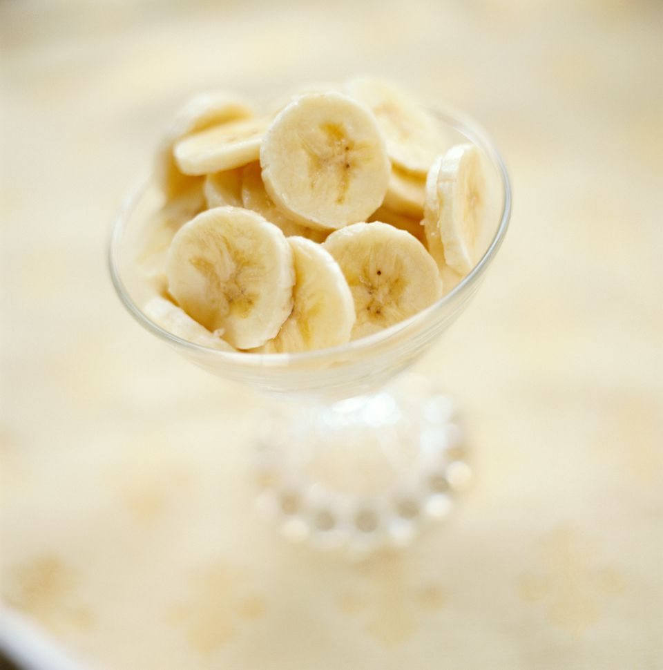 Sliced bananas in dessert bowl, close-up