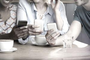 Friends using smartphones.