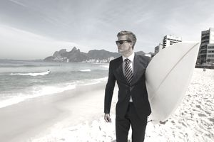 Business man with surfboard in Rio de Janeiro