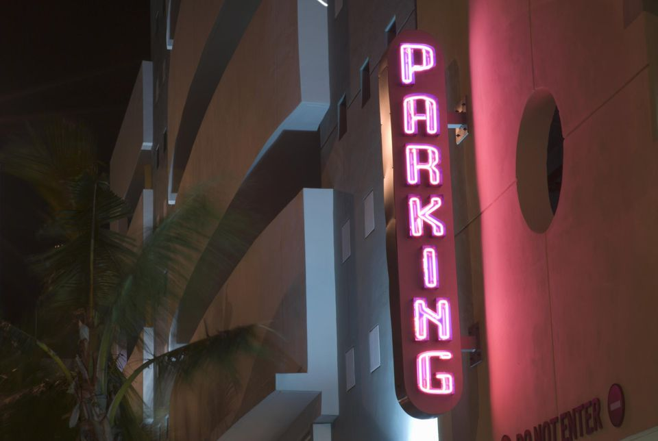 Parking sign with neon lights