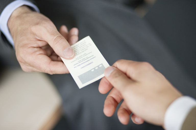 Two men exchanging a business card