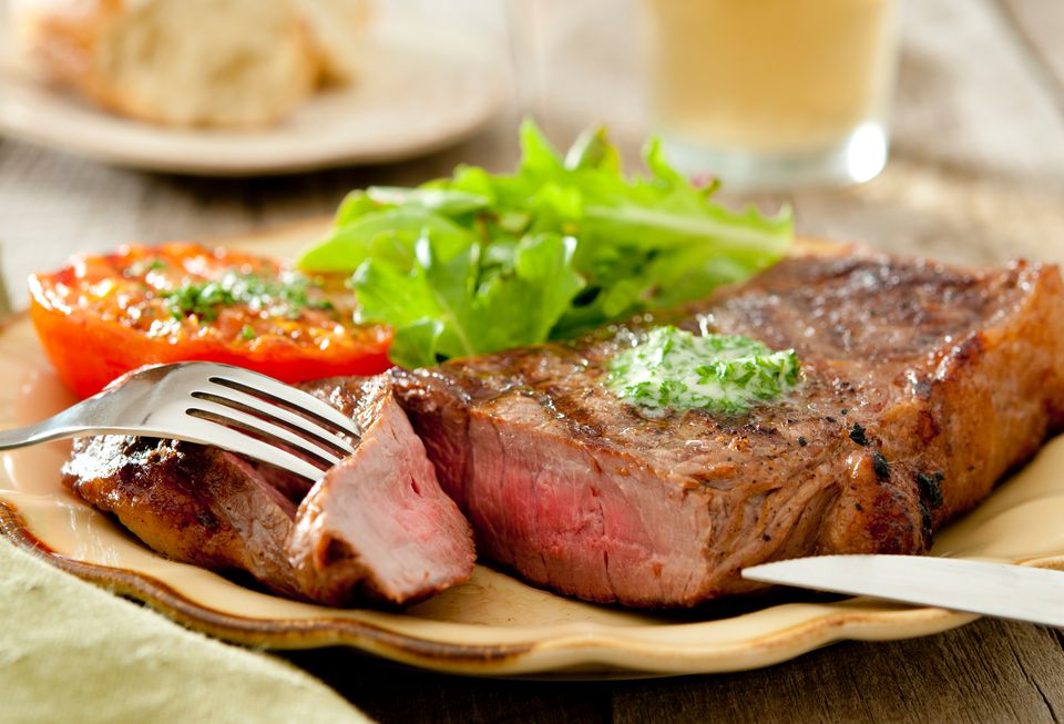 Grilled strip steak with compound butter