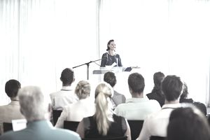 Young businesswoman giving presentation in conference room