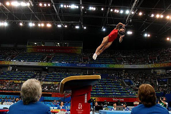 German gymnast Oksana Chusovitina competes on vault at the 2008 Olympics