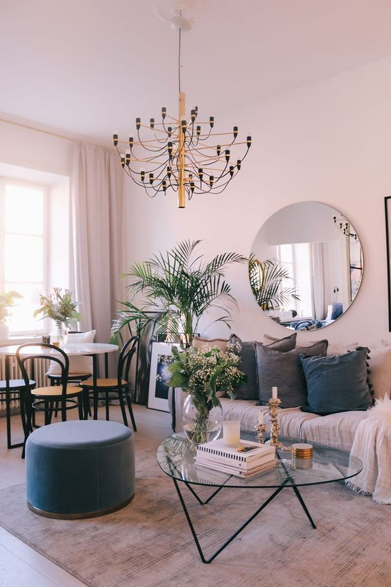 Living and dining room with pink walls and hairpin coffee table