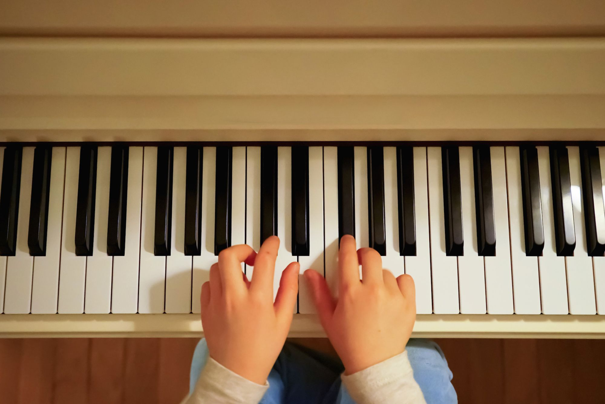 Ascending piano scales piano finger techniques girls hands and piano keyboard close up view education concept hexwebz Images