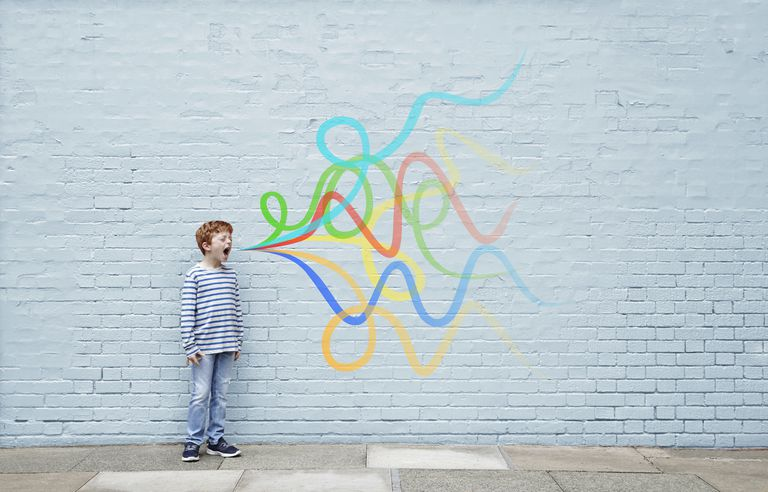 Boy shouting with sound waves