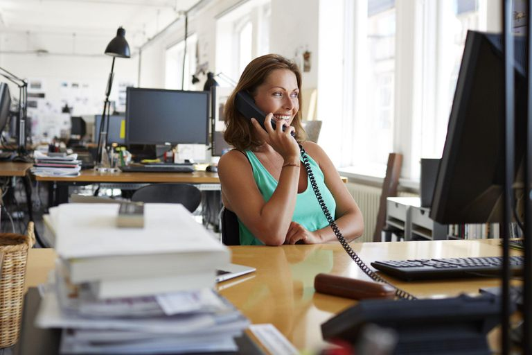 Businesswoman on the phone at design agency