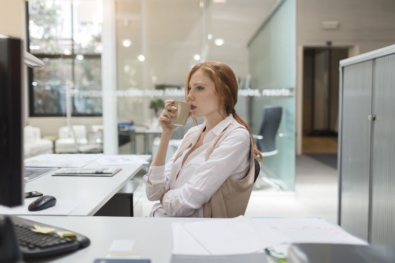 Business woman looking at computer screen.