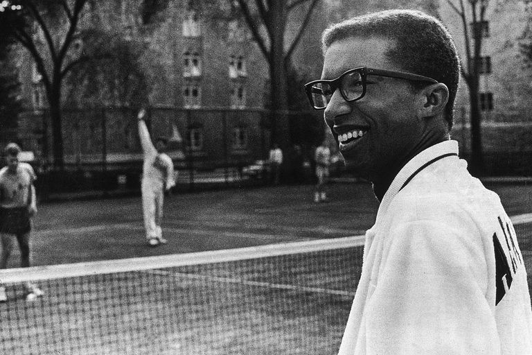 14th October 1968: US Army Lieutenant and National Open Tennis Champion Arthur Ashe (1943 - 1993) surveys the courts while cadets practice, West Point, New York.