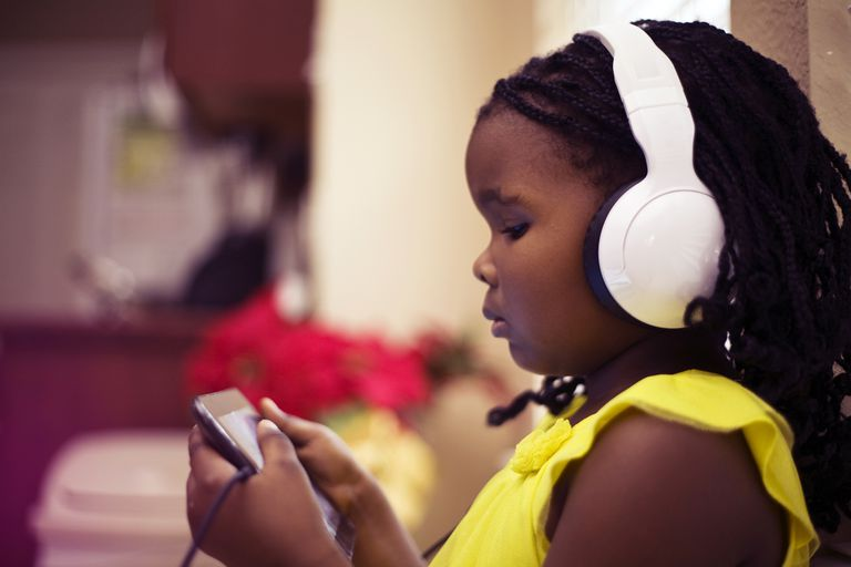 young girl playing games on her phone