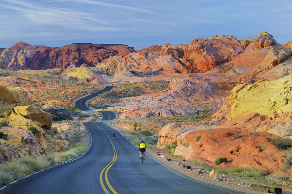 Cyclists on road through the Valley of Fire
