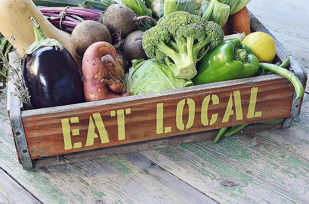 Meaning of fourth -  Eat Local Printed On A Crate Of Vegetables