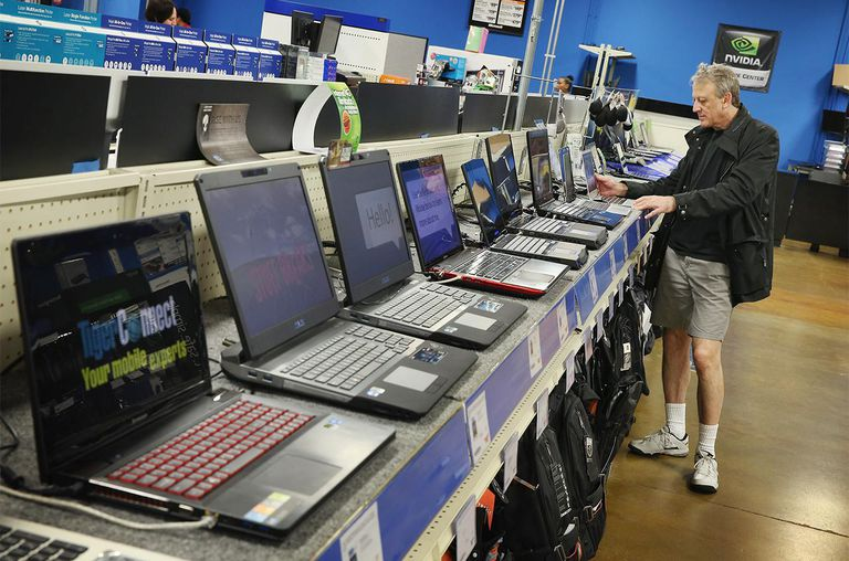 Sergey Zaks shops for a laptop computer at a Tiger Direct store on April 11, 2013.