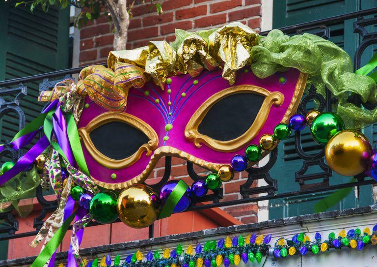 USA, New Orleans, Louisiana, Mardi Gras mask hanging on balcony's railing