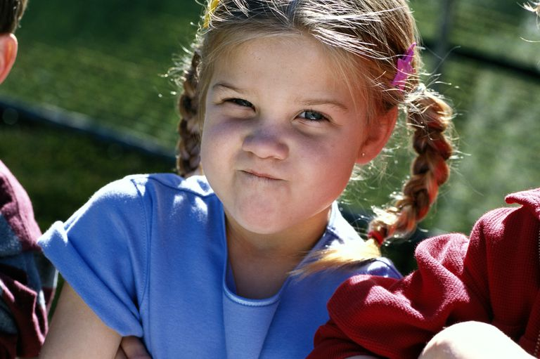 young girl with crossed arms and attitude