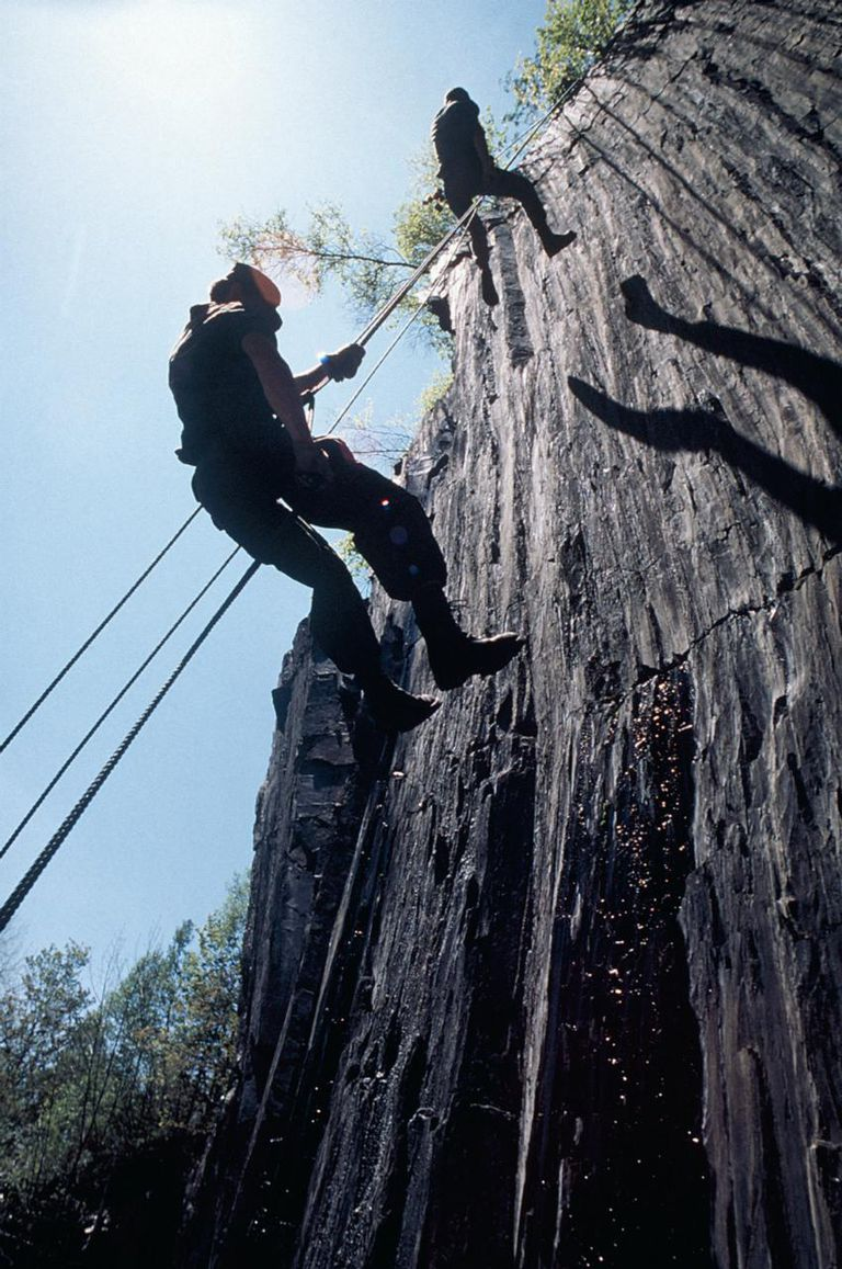 Infantryman rappelling down a cliff