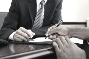 Business people signing a loan agreement