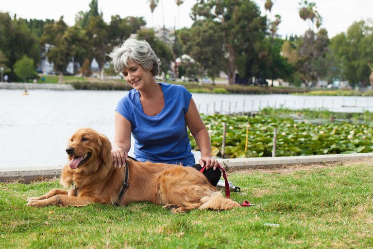 Mature woman sitting with dog