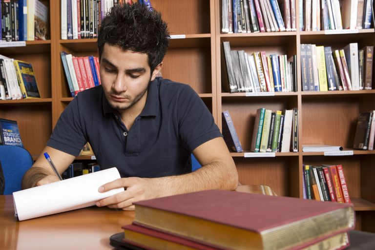A male student studying in the library.