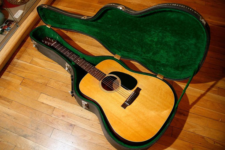 A Martin acoustic guitar used by Bob Dylan on display at the GOTTA HAVE IT! Rock & Roll Pop Culture Auction Press Preview at the Gotta Have It! store on November 30, 2011 in New York City.