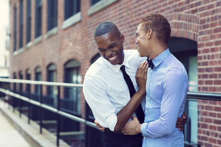 African-American Gay Couple Hugging and Laughing
