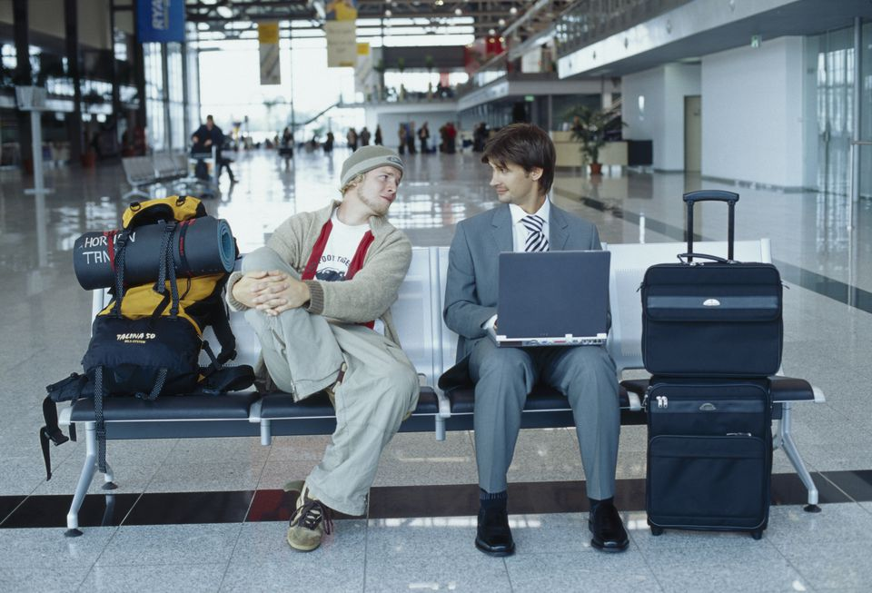 Businessman and backpacker at the airport