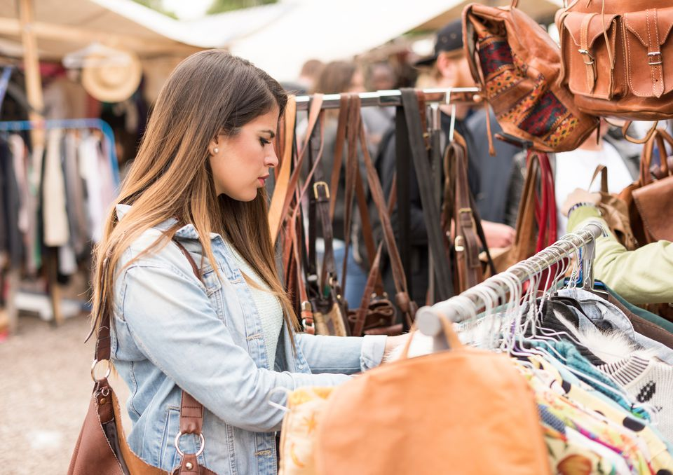 Young woman shopping, Mauerpark Flea Market, Berlin, Germany
