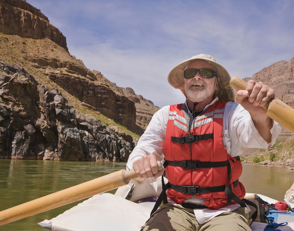 Man rowing oar raft on the Colorado River in Grand Canyon National Park